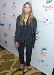 Elizabeth Olsen coordinated her blouse with a pair of black silk pants.