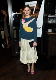 Olivia Palermo added an extra splash of color with a pair of fuchsia and yellow sandals.