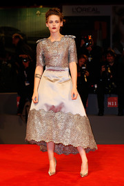 Kristen Stewart completed her high-shine look with silver Christian Louboutin So Kate pumps.