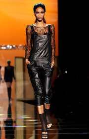 Chanel worked a leather romper for the Ermanno Scervino cat walk in Milan.