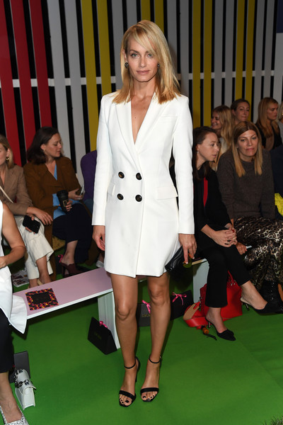 Amber Valletta looked sharp in a white tuxedo dress at the Escada Spring 2019 show.