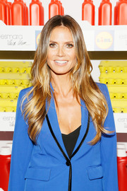 Heidi Klum framed her face with long layered waves for the Esmara by Heidi Klum presentation.