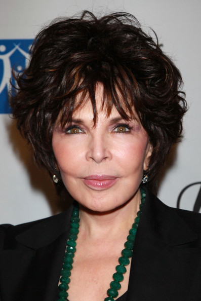 More Pics of Carole Bayer Sager Patent Leather Clutch (1 of 5) - Clutches Lookbook - StyleBistro [songs of hope vi,hair,hairstyle,face,eyebrow,chin,black hair,layered hair,bangs,forehead,brown hair,carole bayer sager,house la,los angeles,california,esquire,esquire house la]
