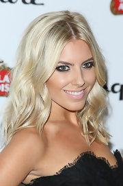 Mollie King chose loose waves for soft and romantic look at the Esquire Summer Party in London.