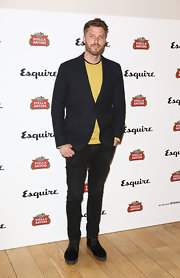 Rick Edwards chose a dark charcoal gray shawl-collar blazer to pair over his mustard yellow sweater.