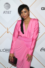 Susan Kelechi Watson paired a snakeskin print clutch with a bubblegum-pink dress for the Essence Black Women in Hollywood Awards.