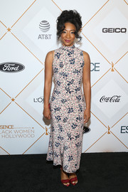 Betty Gabriel chose a sleeveless pink print dress for the Essence Black Women in Hollywood Awards.