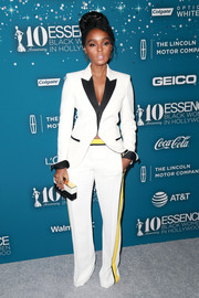 Janelle Monae was sporty-chic in a tricolor pantsuit by Barbara Bui  that the star paired with  L Frank jewelry at the Essence Black Women in Hollywood Awards.