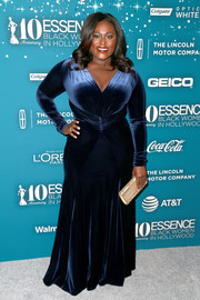 Danielle Brooks paired her Old Hollywood-glam dress with a metallic gold clutch.
