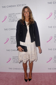 Kelly Bensimon toughened up her white eyelet dress with a black biker jacket for the 'Hear Our Stories' screening.