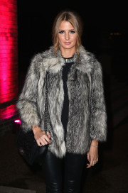 Millie Mackintosh paired a black Chanel chain-strap bag with a gray fur jacket for a totally luxe look during the Estee Lauder event.
