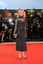 Naomi Watts coordinated her dress with a shimmering box clutch, also by Dolce & Gabbana.