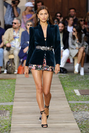 Irina Shayk looked cool and stylish in a blue velvet jacket and floral shorts at the Etro Spring 2020 runway show.