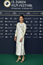 Alicia Vikander attended the Zurich Film Festival premiere of 'Euphoria' wearing a custom Louis Vuitton floral sequin dress.