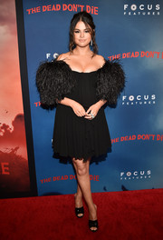 Selena Gomez went frilly in a black off-the-shoulder dress with feather sleeves at the New York premiere of 'The Dead Don't Die.'