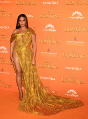 Beyonce Knowles-Carter ravished in a gold one-shoulder gown with a keyhole cutout and a hip-high slit at the European premiere of 'The Lion King.'