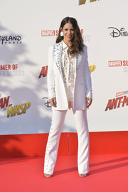 Evangeline Lilly gave us '70s vibes with this embellished white pantsuit by Roberto Cavalli at the European premiere of 'Ant-Man and the Wasp.'