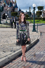 Kaya Scodelario paired her frilly frock with black velvet sandals by Manolo Blahnik.