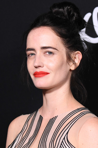 Eva Green Loose Bun [hair,face,hairstyle,lip,eyebrow,chin,shoulder,beauty,black hair,skin,arrivals,eva green,dumbo,los angeles,california,el capitan theatre,disney,premiere,premiere]