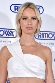 Karolina Kurkova wore her hair in a loose bun for the opening of the Rimowa store in Miami.