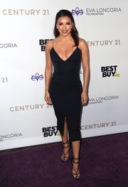 Eva Longoria sealed off her look with black lace-up heels by  Aquazzura.