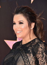 Eva Longoria styled her hair into a loose ponytail for her Hollywood star ceremony.