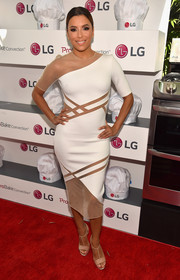 Eva Longoria completed her red carpet look with nude T-strap sandals by Christian Louboutin.