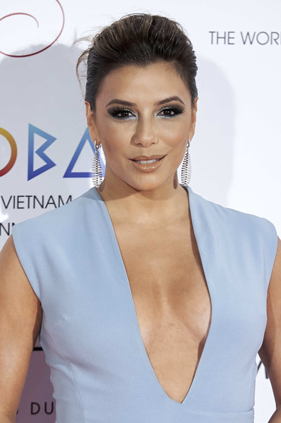 Eva Longoria Loose Bun [eva longoria,royal teather,hair,face,hairstyle,beauty,eyebrow,skin,lip,shoulder,eyelash,dress,global gift madrid gala,global gift gala,madrid,spain]