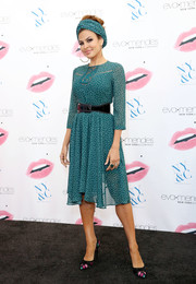 Eva Mendes looked very ladylike in this dotted teal dress from her line during the launch of her Fall collection.