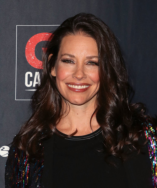 Evangeline Lilly Long Curls [hair,face,hairstyle,eyebrow,chin,forehead,premiere,long hair,smile,layered hair,arrivals,evangeline lilly,city market social house,los angeles,california,go campaign gala]