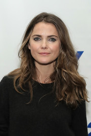 Keri Russell wore her hair down in casual center-parted waves during the Evening with 'The Americans' event.