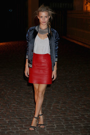 Georgia May Jagger was sporty-edgy in a red leather mini skirt and a black track jacket at the Global Fund event.