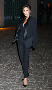 Victoria Beckham went for androgynous elegance at the Global Fund event in a black tux of her own design.
