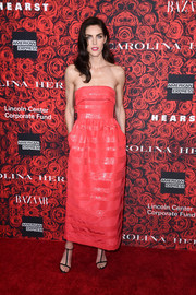 Hilary Rhoda chose simple black T-strap sandals to finish off her look.