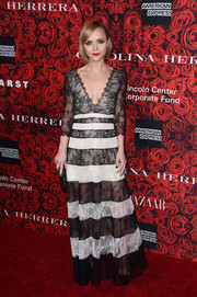 Christina Ricci worked a boldly striped lace gown with a deep-V neckline at the Evening Honoring Carolina Herrera event.