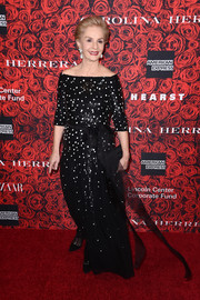 Carolina Herrera attended an event in her honor wearing a black-and-white polka-dot off-the-shoulder gown.