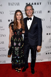 Miroslava Duma charmed in a floral-embroidered maxi dress at the Evening Honoring Valentino Gala.