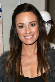 TV personality Catt Sadler framed her face by sweeping her bangs over to one side and pinning them back. Simple yet very effective.