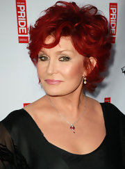 Sharon Osbourne finished off her look with a mussed-up razor cut.