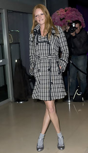 Actress Olivia Inge wore striped socks below these t-strapped silver pumps.