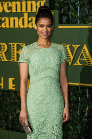 Gugu Mbatha-Raw paired a silver box clutch with a mint-green lace dress for the 2015 Evening Standard Theatre Awards.