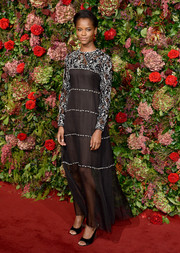 Letitia Wright kept it classy in a black Chanel gown with an embroidered yoke and sleeves at the 2018 Evening Standard Theatre Awards.