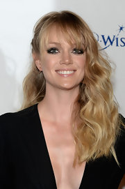 Lindsay Ellingson chose a long wavy 'do with blunt bangs to show off her pretty blonde locks.