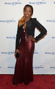 Estelle wore a metallic cranberry gown on the red carpet of the Make-A-Wish Metro Gala.