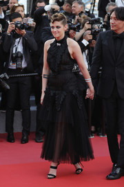 Kristen Stewart dolled up in a ruffled black halter dress by Chanel for the 2018 Cannes Film Festival opening gala.