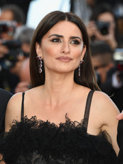Penelope Cruz went for a simple center-parted styled when she attended the 2018 Cannes Film Festival opening gala.