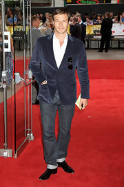 Paul Sculfor showed off his navy blue blazer while hitting the red carpet.