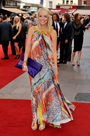 Liz paired her printed maxi dress with a vibrant purple clutch.