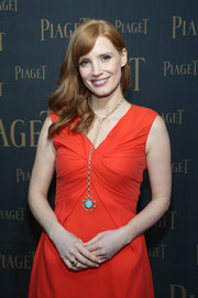 Jessica Chastain attended the Extremely Piaget launch wearing an eye-catching gold chain necklace with a turquoise pendant.