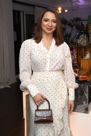 Maya Rudolph accessorized with a brown croc-embossed purse at the By Far party.